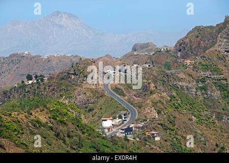 Houses along winding road through volcanic mountains in the interior of the island of Santiago, Cape Verde / Cabo - Stock Photo
