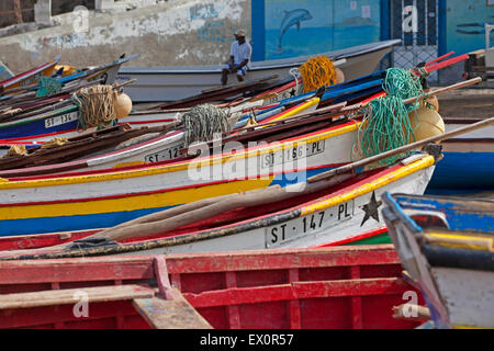 Colourful traditional wooden fishing boats in the harbour of Tarrafal on the island Santiago, Cape Verde / Cabo - Stock Photo
