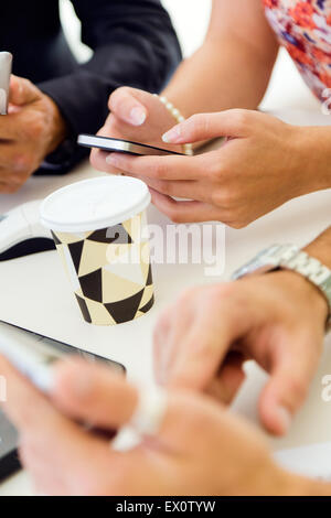 Portrait of businesswoman using mobile phone at a meeting. - Stock Photo