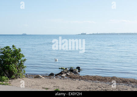Landscape with the baltic sea and Kronborg castle as seen from Sweden - Stock Photo