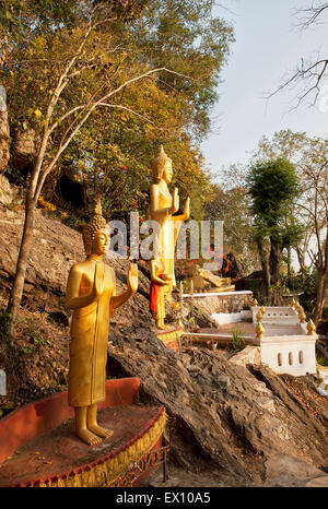 These golden statues on the Ban Khamyong side of Mt. Phou Si. depict the 7 positions of Buddha. - Stock Photo