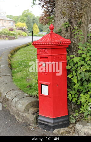 A Victorian red pillar box of the Penfold  type in Buxton Derbyshire England UK - in use, 2015 - Stock Photo