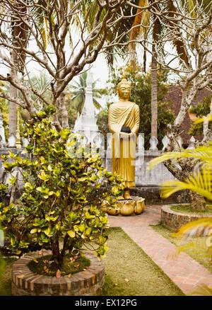 A garden of Buddhas inside Wat Choumkhong. The Buddhas show some of the 7 positions of Buddha.Luang Prabang,Laos - Stock Photo