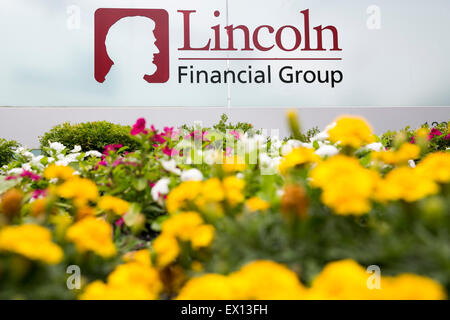 A logo sign outside the headquarters of the Lincoln National Corporation, parent company of the Lincoln Financial - Stock Photo