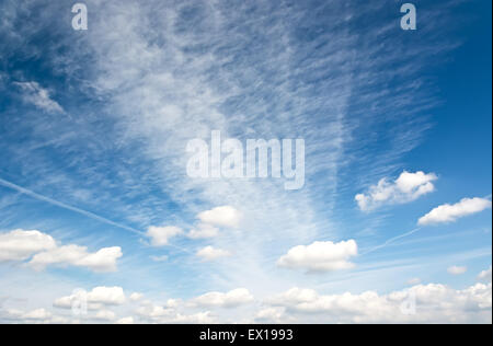 Cirrus and cumulus clouds in the blue sky morning. - Stock Photo