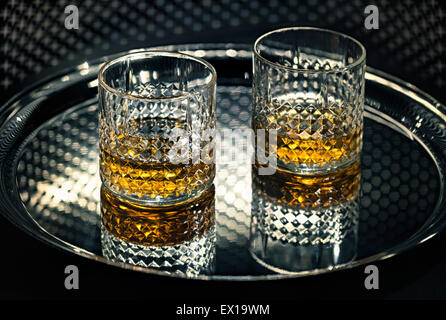 Whiskey glasses on the tray. - Stock Photo