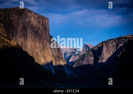 Yosemite Valley from Tunnel View. late evening sunshine with snow on the peaks - Stock Photo