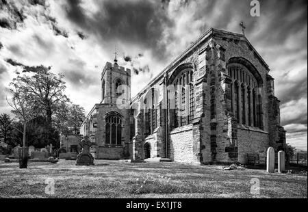 dramatic mono low angle image of Castle Ashby parish church in Northamptonshire - Stock Photo