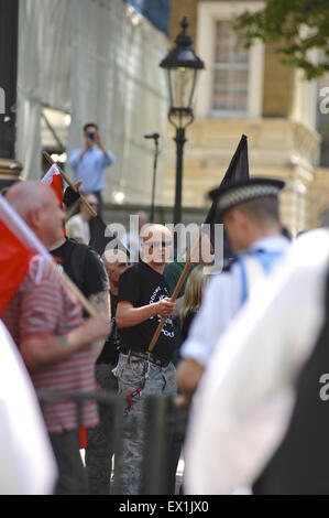 London, UK. 04th July, 2015. A member of Narodowe Odrodzenie Polski  (National Rebirth of Poland) holding a black - Stock Photo