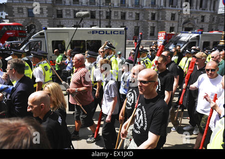 London, UK. 04th July, 2015. Neo-nazis being escorted to Westminster Tube after their demonstration with a a tight - Stock Photo