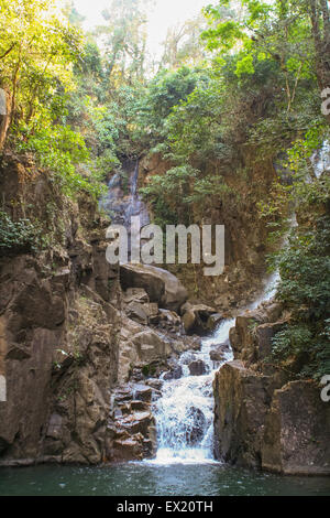 Waterfall in mountains in national park of Thailand. - Stock Photo