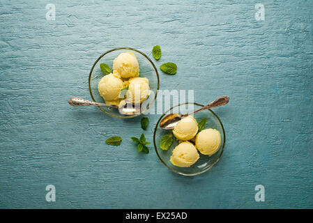 Fresh fruit sorbet ice cream in a glass plate - overhead shots. - Stock Photo