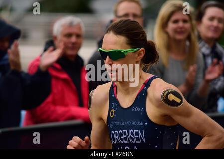 Gwen Jorgensen running in a triathlon - Stock Photo