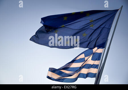 Athens, Greece. 04th July, 2015. The Greek flag flies next to flag of the flag of the European Union in the wind - Stock Photo