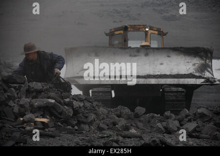Miners work at a coal mine site in Huaibei, Anhui province February 7, 2010. VCP - Stock Photo