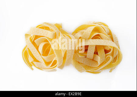 egg fettuccine pasta on white background - Stock Photo