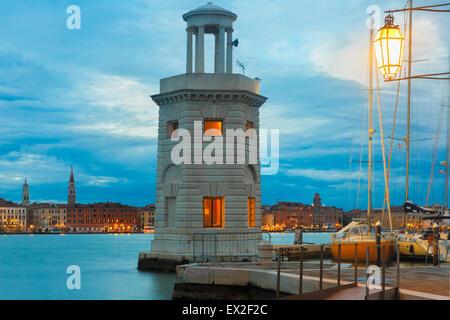 Lighthouse on island San Giorgio Maggiore, Venice - Stock Photo