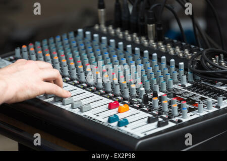 A sound mixing board at a music gig - Stock Photo