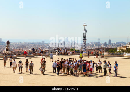 Tourists in Park Guell ( Parc Guell ), designed by Antoni Gaudi, a UNESCO World Heritage Site, Barcelona Spain Europe - Stock Photo