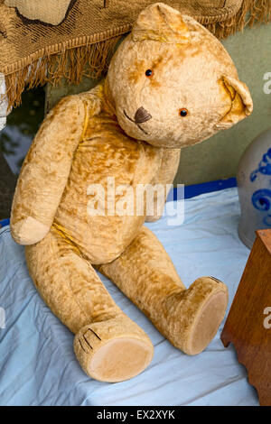Worn Teddy bear for sale at a bric-a-brac street market along the canals in the city  of Delft, South Holland, The - Stock Photo