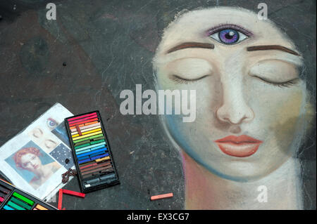 An unfinished portrait of a woman and art supplies at the annual Imadonnari Street Painting Festival in Santa Barbara, - Stock Photo