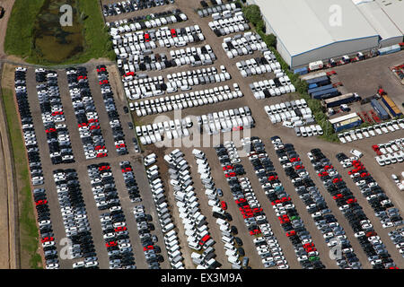 aerial view of parked cars & vans outside a factory in Stoke on Trent, UK - Stock Photo