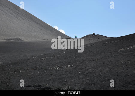near the summit of mount etna sicily with the black volcanic rock and steam - Stock Photo