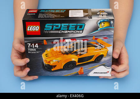 Tambov, Russian Federation - March 04, 2015 LEGO Speed Champions box with McLaren P1 in childs hands. Studio shot. - Stock Photo