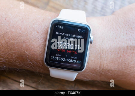 Summary of Dow Jones Industrial Average stock market performance  showing on an Apple Watch - Stock Photo