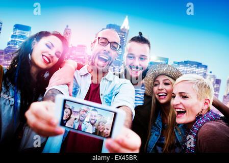 Diverse People Friends Fun Bonding Smart Phone Concept - Stock Photo