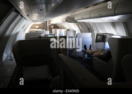 The upper deck of a British Airways Boeing 747 Jumbo Jet. - Stock Photo