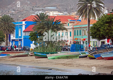 Fishing boats on beach along waterfront of old colonial historic center of the city Mindelo on São Vicente, Cape - Stock Photo