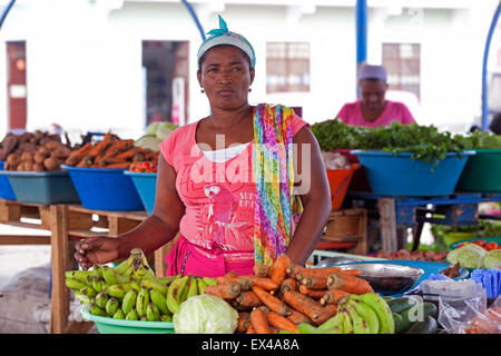 Creole woman selling fresh fruit and vegetables at market in the city Mindelo on the island São Vicente, Cape Verde, - Stock Photo