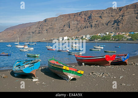 Colourful wooden fishing boats on the black sand beach of Tarrafal de São Nicolau on the island São Nicolau, Cape - Stock Photo