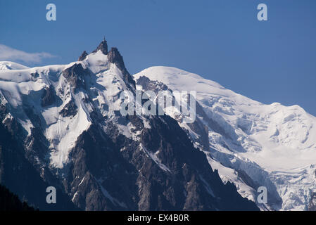 Aiguille du midi and Mont Blanc in July - Stock Photo