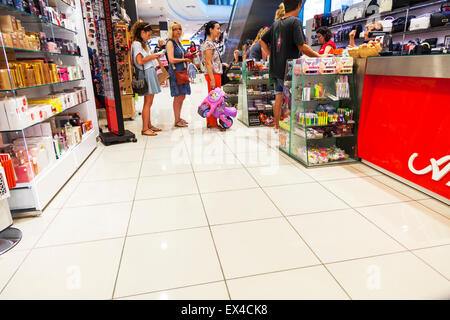Queuing up to pay for goods in shop store Queue at till tills inside copy space copyspace - Stock Photo
