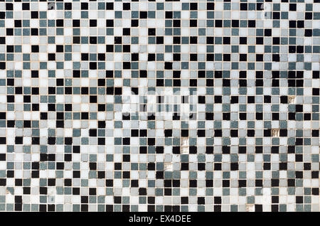 White, black and grey mosaic tiles in a bathroom - Stock Photo
