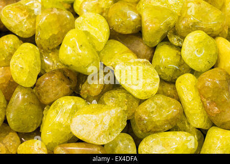 A background of some yellow semiprecious pebbles - Stock Photo