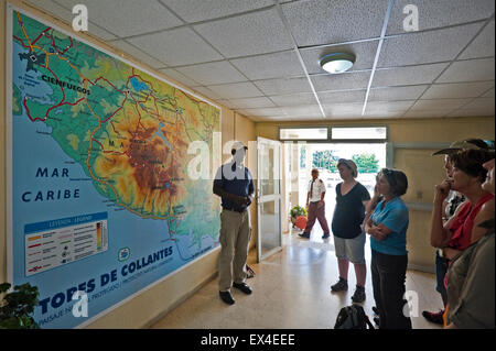 Horizontal view of a tour guide explaining routes to a group of tourists in Topes de Collantes National Park in - Stock Photo