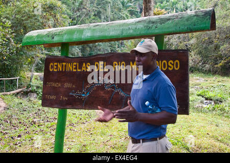 Horizontal portrait of a tour leader in Topes de Collantes National Park in Cuba. - Stock Photo