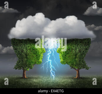 Business spark idea concept as two trees shaped as a head under a storm cloud creating a thunderbolt of lightning - Stock Photo