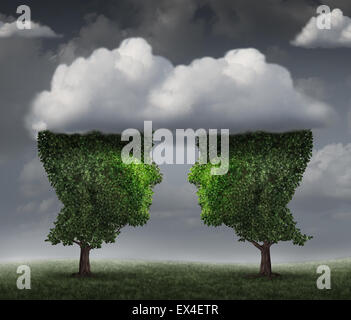 Cloud relationship and growing network communication with a group of two trees shaped as a human head in the clouds - Stock Photo