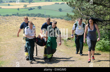 Shropshire Ambulance Service and Shropshire Fire and Rescue officers carry injured woman back to ambulance Wrekin - Stock Photo