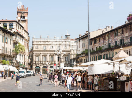 VERONA, ITALY - JUNE 3: Tourists at the Piazza delle Erbe in the historic center of  Verona, Italy on June 3, 2015. - Stock Photo