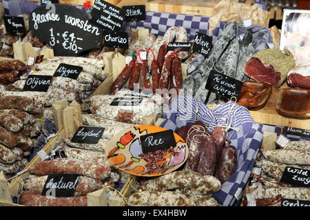 Sausages and meat products on sale in the Markthal Rotterdam in Rotterdam, the Netherlands. - Stock Photo