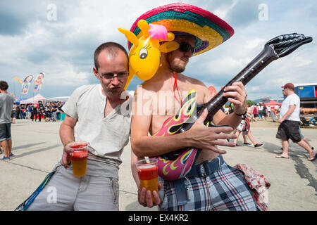 PIESTANY, SLOVAKIA - JUNE 27 2015: Visitors of Slovak music festival Topfest having fun while playing on inflatable - Stock Photo