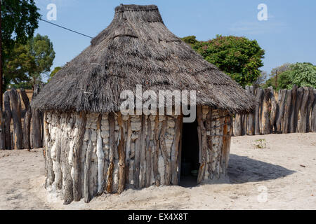 Traditional african village with housed and wooden fence in Namibia, near town Kavango in region with the highest - Stock Photo
