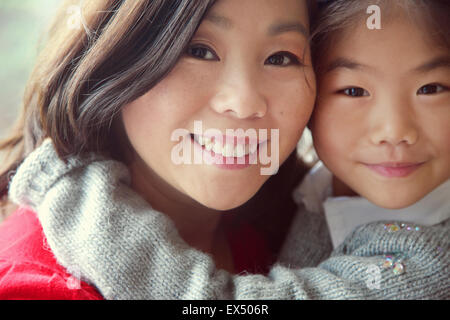 Mother and Daughter Embracing, Close-up view - Stock Photo