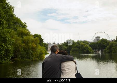 Couple Embracing, St. James's Park Lake, London, England - Stock Photo