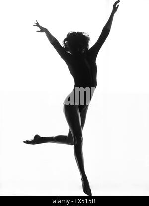 Female Dancer Leaping Mid air - Stock Photo